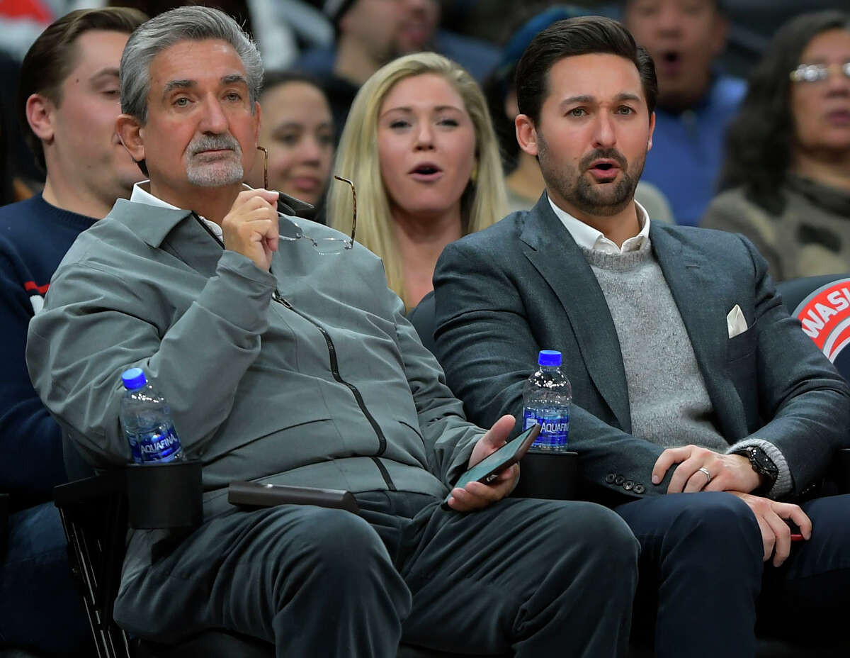 Ted Leonsis, left, and his son Zachary watch a Wizards game in early 2020.