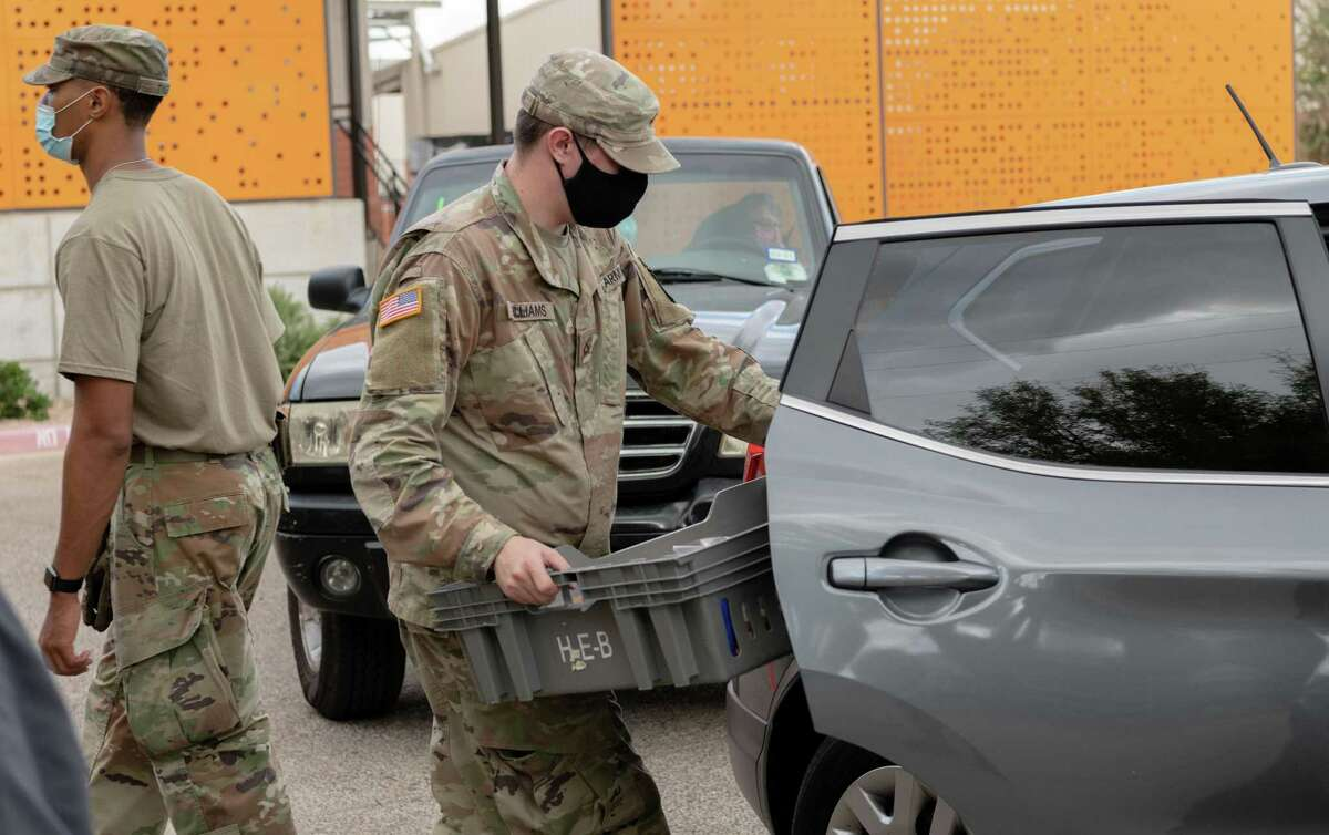 South Texas Food Bank staff and members of the Army National Guard provided Thanksgiving meals to 400 local families Monday.