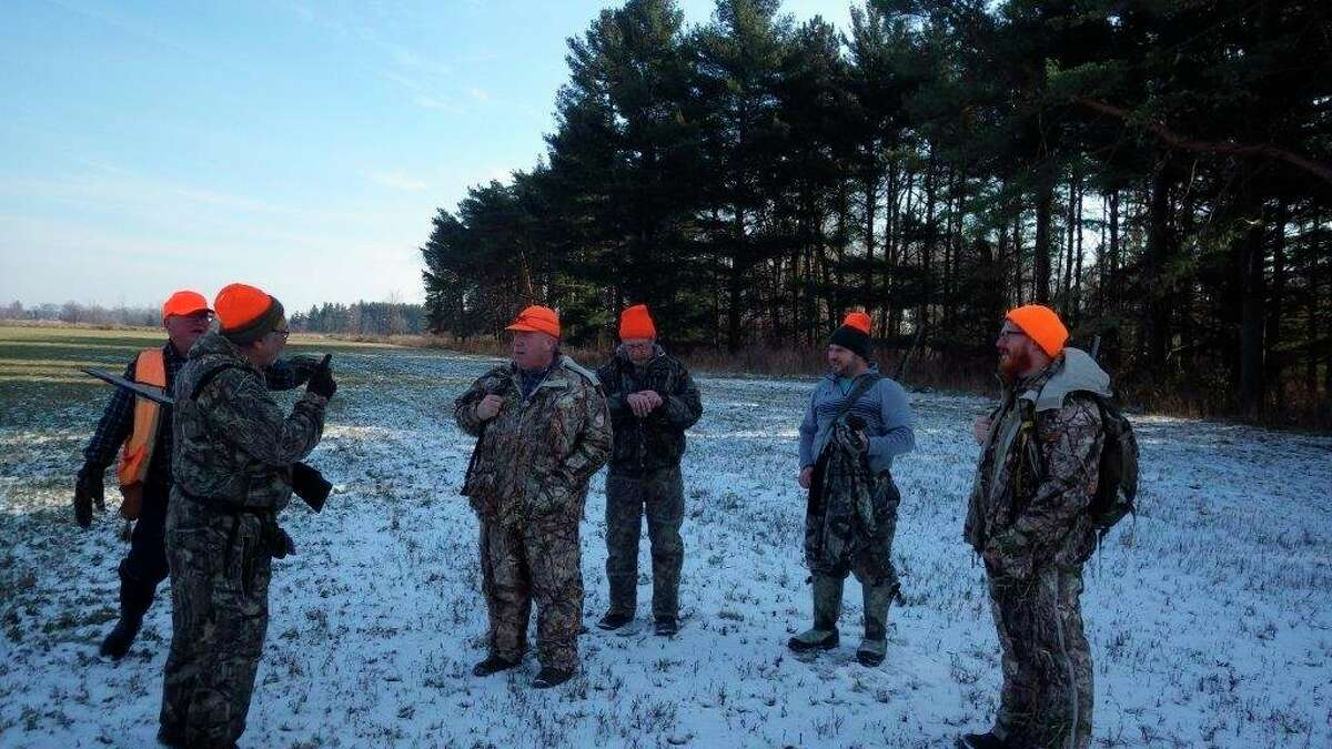 Thumb deer hunters prepare for a late-season deer drive. Wind directionand proper placement of standers are essential elements toany success with verywary whitetails. (Photo provided/Tom Lounsbury/Hearst Michigan)