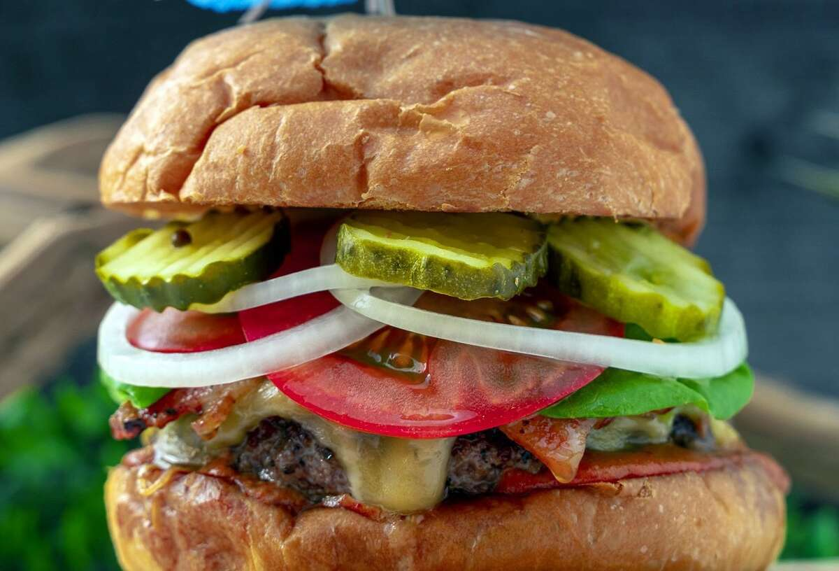 The menu features made-to-order burgers such as the Good Vibes Signature.
