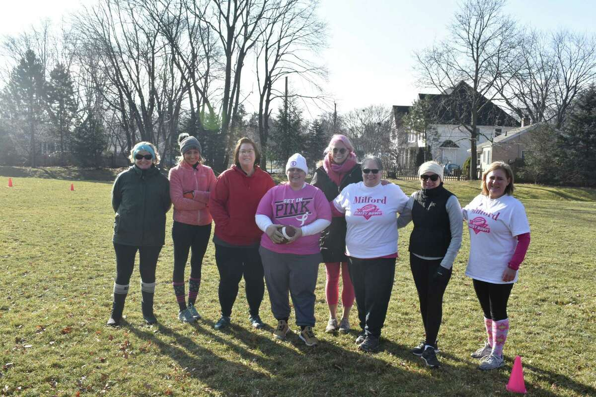 Rotary Club of Milford members playing in the DZ Bowl Tournament to raise money for breast cancer awareness