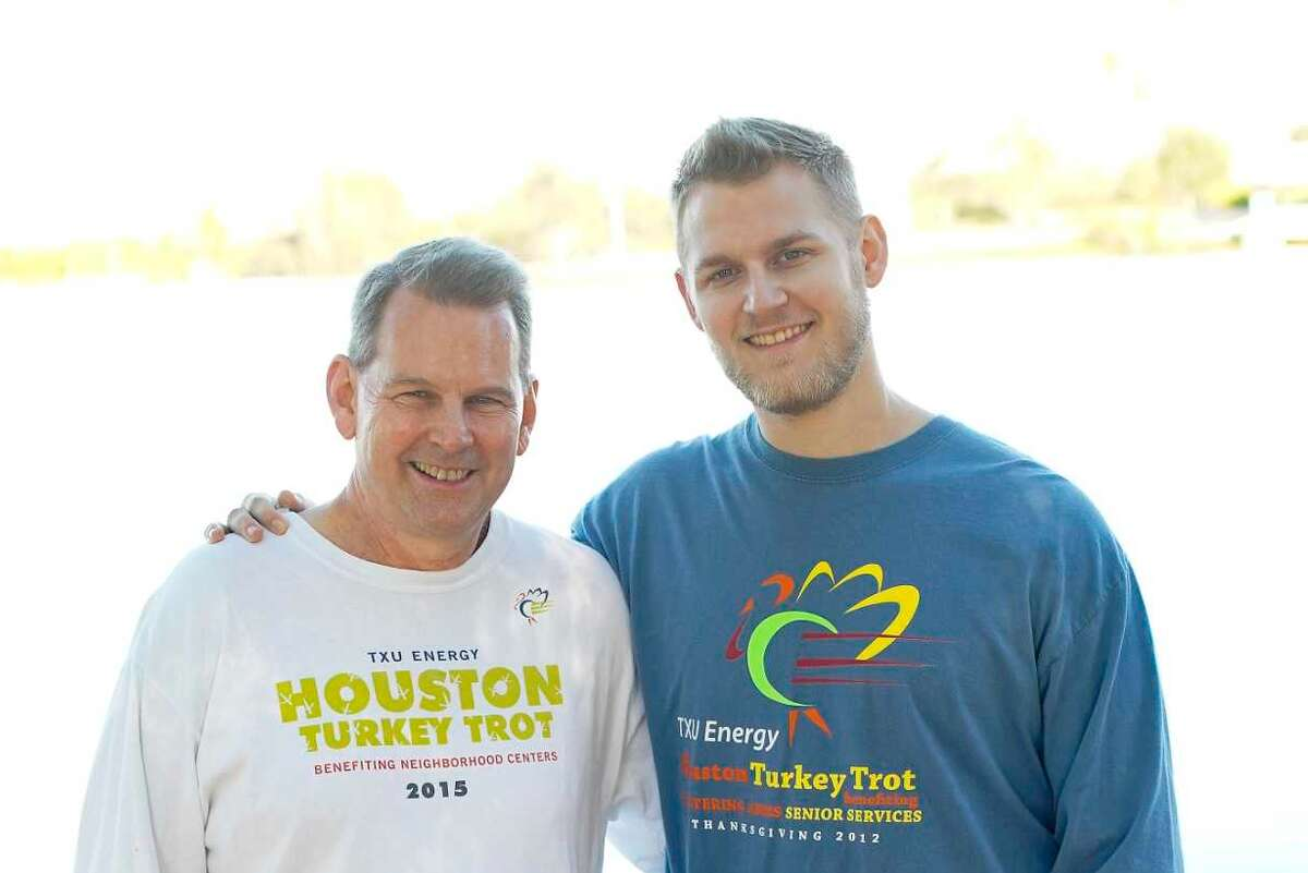 Todd Breton, left, and his son, Michael in Sugar Land on Wednesday, Nov. 18, 2020. Todd Breton has run every Houston Turkey Trot since it started and will do so virtually this year.
