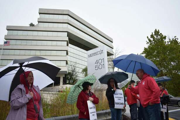 Union members demonstrate outside the Merritt 7 Corporate Park headquarters of Frontier Communications in Norwalk, Conn., on Thursday, Oct. 17, 2019. The rally was organized by the Communications Workers of America, as CWA Local 1298 continues negotiations with Frontier for a new contract and with members having authorized union leaders to call a strike in any impasse.