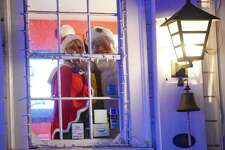 """Ivoryton Playhouse invites you to participate in its new story project, """"A Christmas Quilt of Memories."""" Share your holiday story via email or phone. Stories that are chosen to be turned into songs or scenes performed by actors on video will be presented on the venue's website/social media pages. Two per week will be featured through year's end. Santa and his helper (Jacqueline Hubbard, executive/artistic director of Ivoryton Playhouse) are seen here awaiting your stories."""