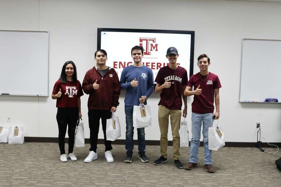 """Members of the Texas A&M University-Concho Engineering Academy at Midland College second-year student cohort are Añanna Vela, ocean engineering major, from left,; Esteban Ballinas, electrical engineering major; Andrew Sanchez, biomedical engineering major; Lane Tang, computer engineering major; and Cristian Valeriano, mechanical engineering major. The Midland Aggies Moms Club last week presented the students with gift bags that included homemade cookies and Texas A&M """"swag"""" to help them get through final exams. Photo: Courtesy Photo"""