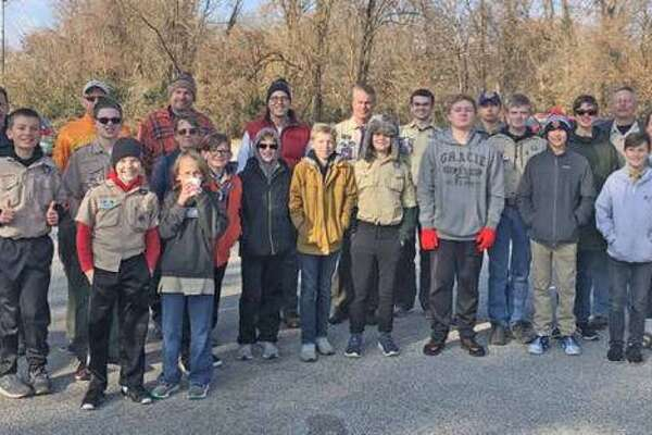 Boy Scout Troop 8216 of Edwardsville during pickup day of the Scouting for Food event in November 2019. This year, the Boy Scouts will not do neighborhood pickup due to COVID-19 concerns but will instead have dozens of drop-off locations in the St. Louis area, including at least 10 in Madison County