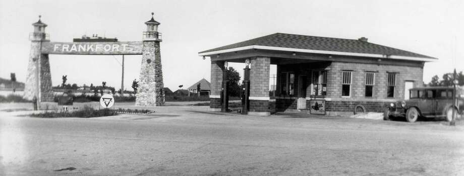 A gas station located at the corner of M-22 and Main Street in Frankfort, circa late 1920s. The mineral spring cupola is in the background. This is the current location ofthe present BP station and the future site of the library on opposite side of the Gateway Arch. (Courtesy Photo)
