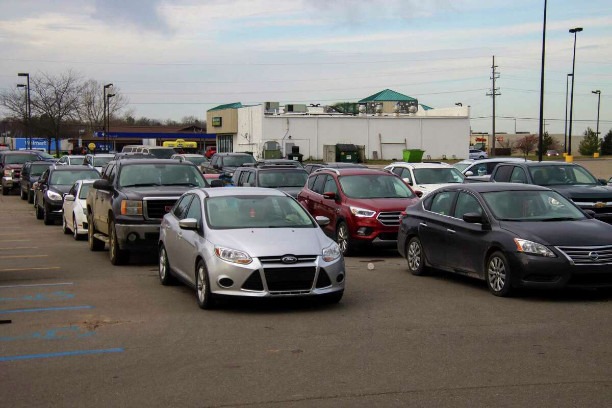 Dozens of vehicles line up for COVID-19 testing outside the Great Lakes Bay Health Center in Bad Axeprior to the Thanksgiving holiday. (Scott Nunn/Tribune File Photo)