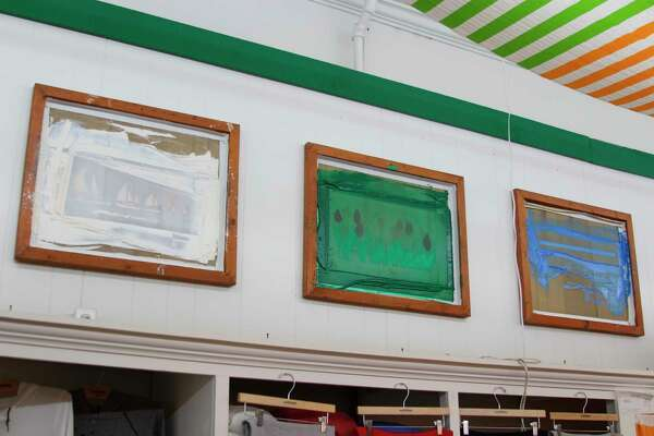 The Michigan Rag Company store in Frankfort displayed some of the screens used to make the unique shirt prints. (Photo/Colin Merry)