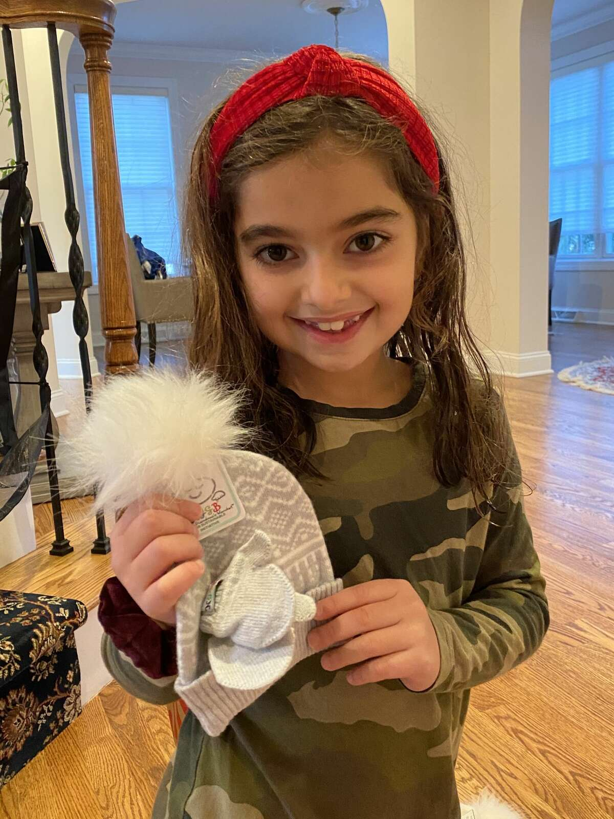 Seven-year-old Jackie Kubikian and her parents, Dave and Isabel, have been collecting winter clothing to donate to Armenian children following the six-week war with Azerbaijan.