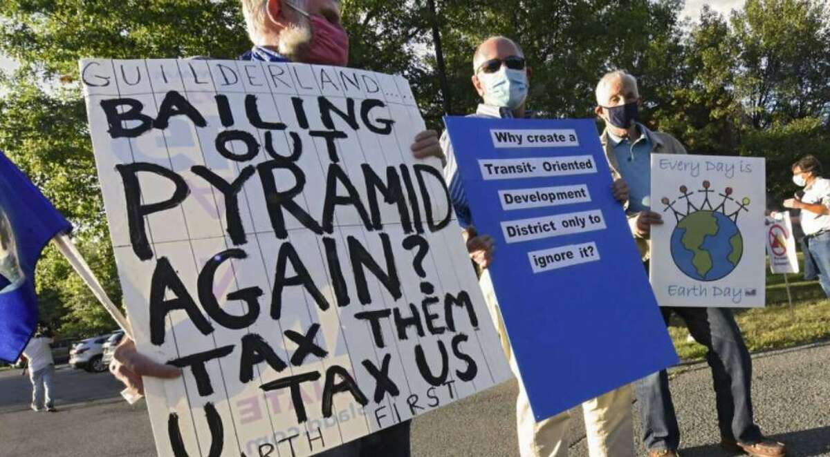 Protesters gather outside of Guilderland Town Hall to push the planning board to do a complete environmental review of the plan to build a Costco warehouse store next to Crossgates Mall on Wednesday, Aug. 26, 2020 in Guilderland, N.Y