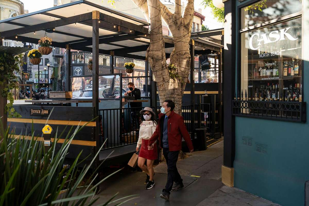 Open spaces such as the Devil's Acre bar parklet along Columbus Avenue provided an alternative place to gather.