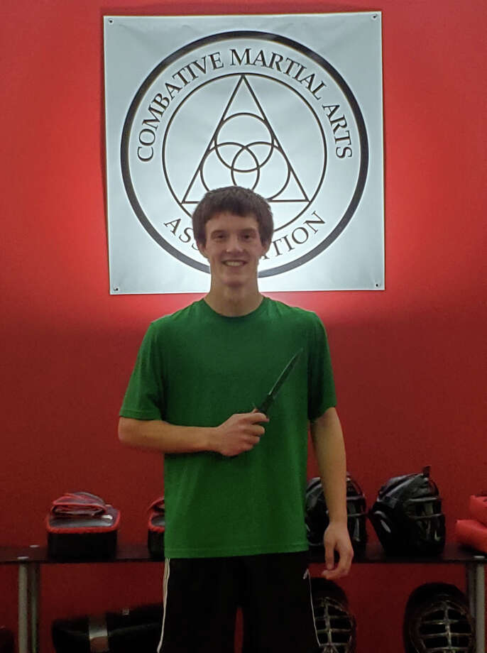 Kyle Kutzke recently earned a black belt in Combat Martial Arts from The Academy. Photo: Photo Provided