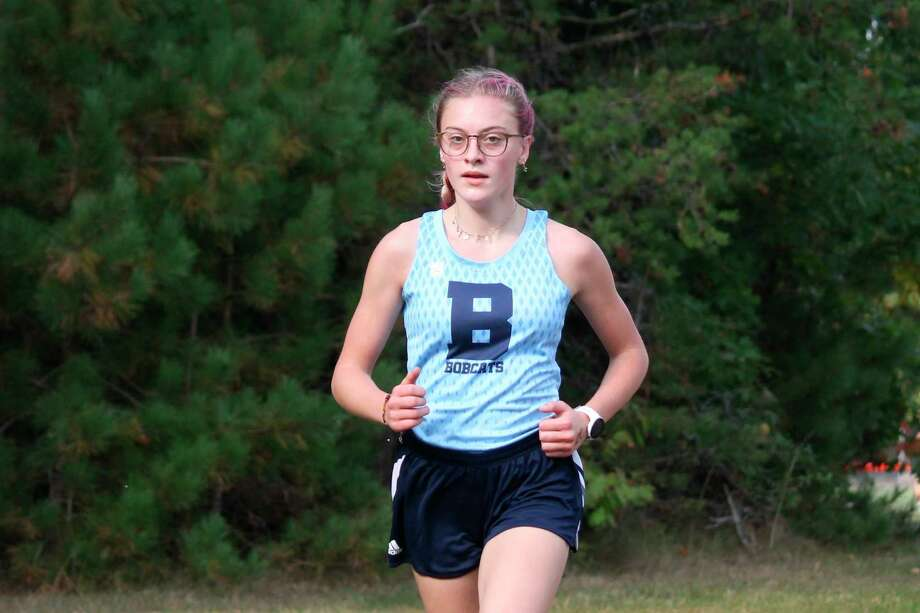 A three-time academic all-state finisher, Alexis Tracy races at Bear Lake on Sept. 26. (File photo)