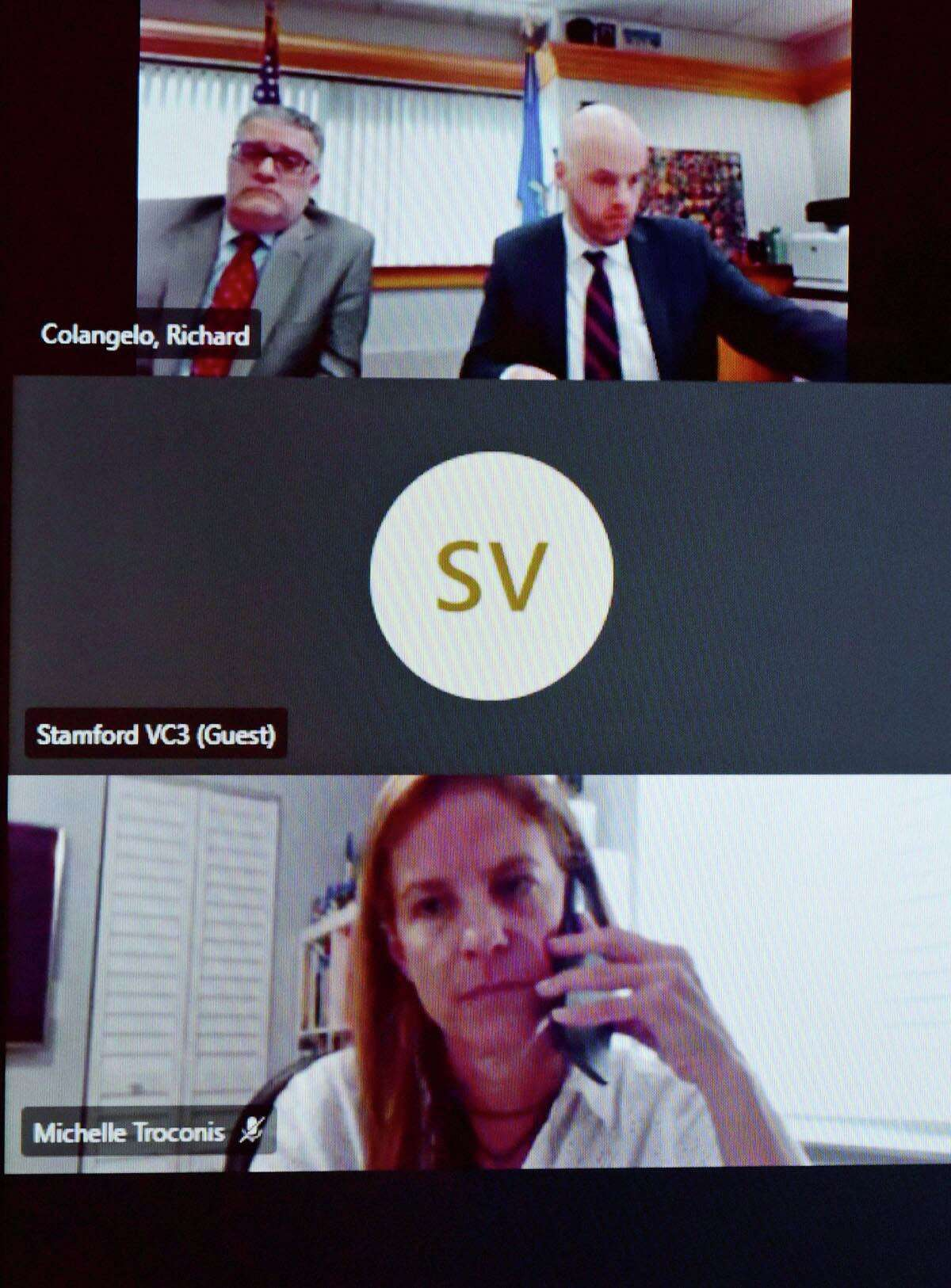 Attorneys and court staff convene via video conference during a hearing for Michelle Troconis on conspiracy to commit murder charge Tuesday, November 24, 2020, at Stamford Superior Court in Stamford, Conn. Troconis was charged in connection with the murder of New Canaan resident Jennifer Dulos.