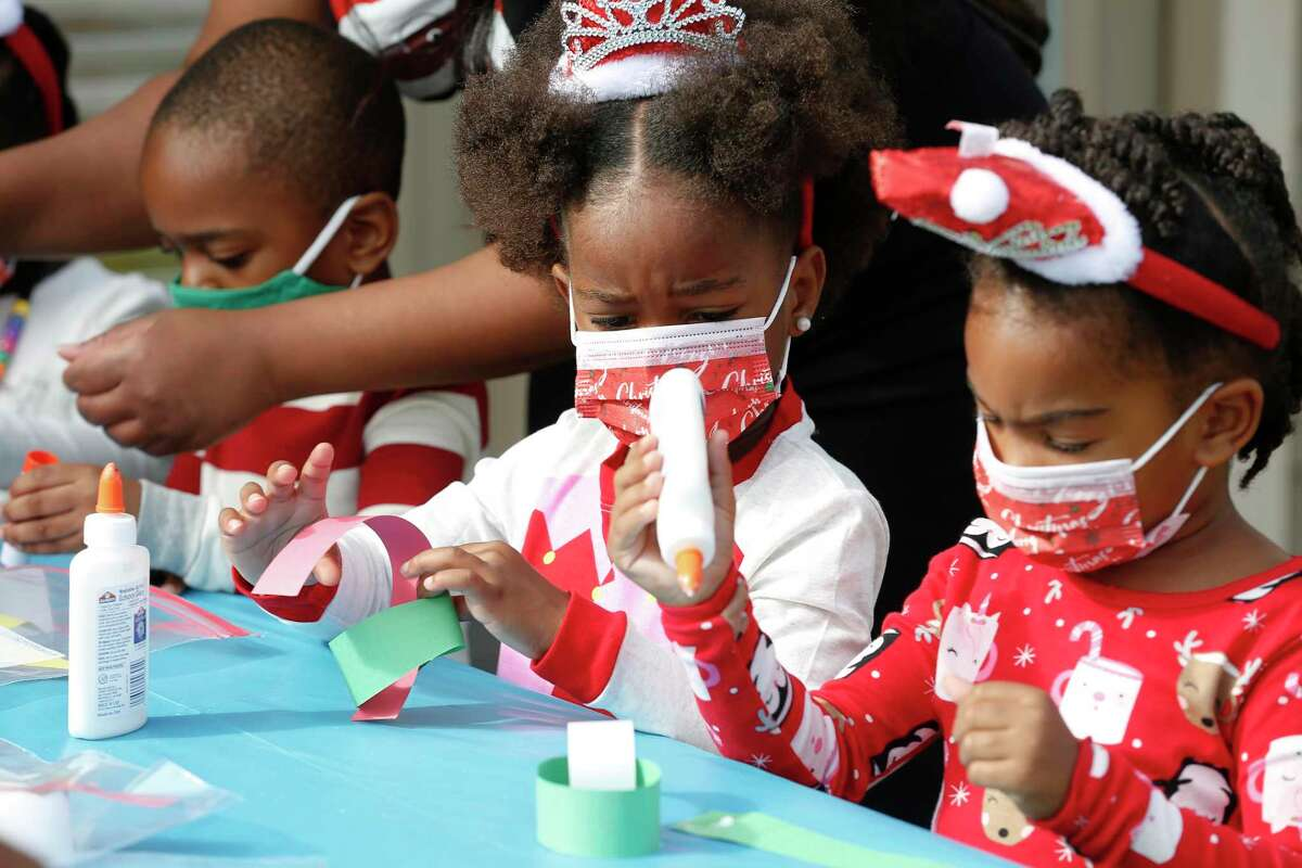 Urennaya Unaka and Avery Mclenan do crafts at the Black Girl Magic School during Santa's visit.