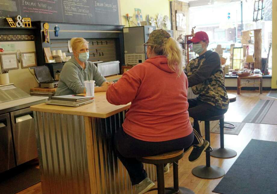 Yellow Window owner Kelly Dennis speaks with somecustomers at her lunch counter during business hours last week. (Pioneer photo/Joe Judd)