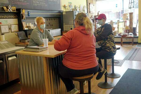 Yellow Window owner Kelly Dennis speaks with some customers at her lunch counter during business hours last week. (Pioneer photo/Joe Judd)