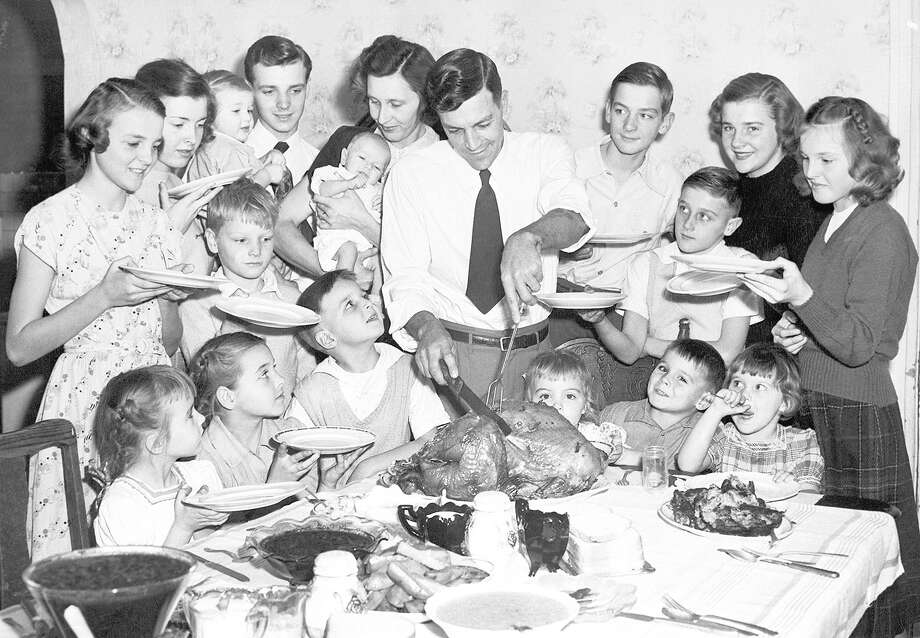 The Raymond Baker family of 18 members in Joliet decided to celebrate Thanksgiving early in 1948 so mother Nora Baker had more time to buy presents for the 16 children. Photo: Bettmann | Bettmann Archive
