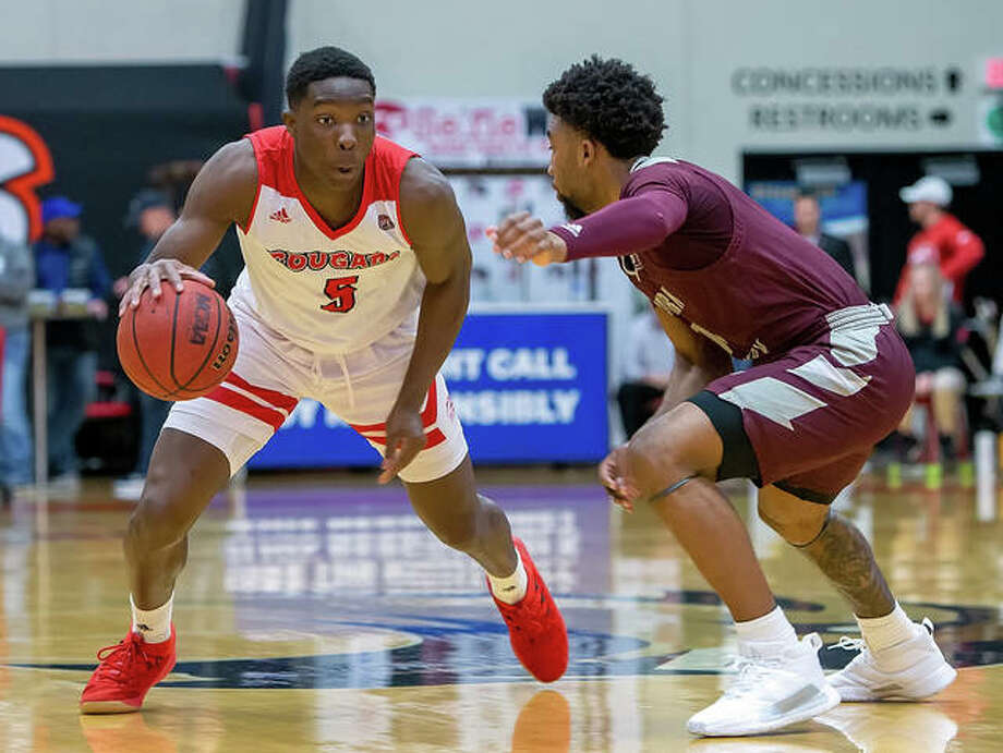 SIUE's Mike Adewunmi (left) drives on Eastern Kentucky's Jomaru Brown during a OVC men's basketball game last season at First Community Arena in Edwardsville. Adewunmi, back for his senior season, and the Cougars open the 2020-21 season Wednesday at Saint Louis. Photo: Scott Kane / SIUE Athletics