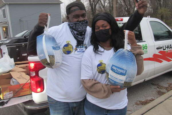 Jerheart Huntley and Jami Goddman of Prosper Credit Consultants handed out 100 free turkeys Monday afternoon in Alton.