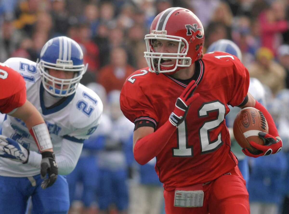 New Canaan's Kurt Ondash (12) cuts back across the field on his way to a touchdown during the 2008 Turkey Bowl and FCIAC football final between New Canaan and Darien at Stamford's Boyle Stadium.
