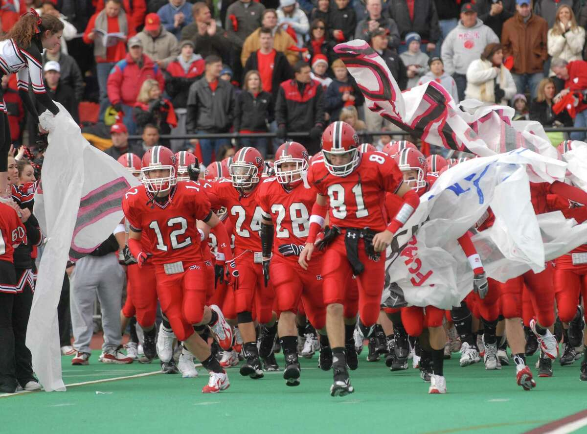 The Rams enter the field for the 2008 Turkey Bowl and FCIAC football final between New Canaan and Darien at Stamford's Boyle Stadium.