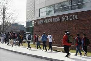 Students enter Greenwich High School in Greenwich, Conn. Monday, Feb. 27, 2017.