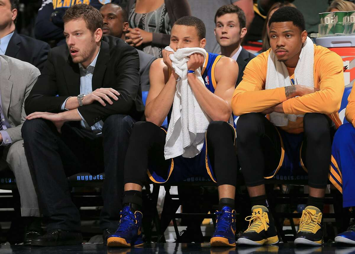 DENVER, CO - APRIL 30: (L-R) David Lee #10, Stephen Curry #30 and Kent Bazemore #20 of the Golden State Warriors during Game Five of the Western Conference Quarterfinals of the 2013 NBA Playoffs at the Pepsi Center on April 30, 2013 in Denver, Colorado. The Nuggets defeated the Warriors 107-100. NOTE TO USER: User expressly acknowledges and agrees that, by downloading and or using this photograph, User is consenting to the terms and conditions of the Getty Images License Agreement. (Photo by Doug Pensinger/Getty Images)