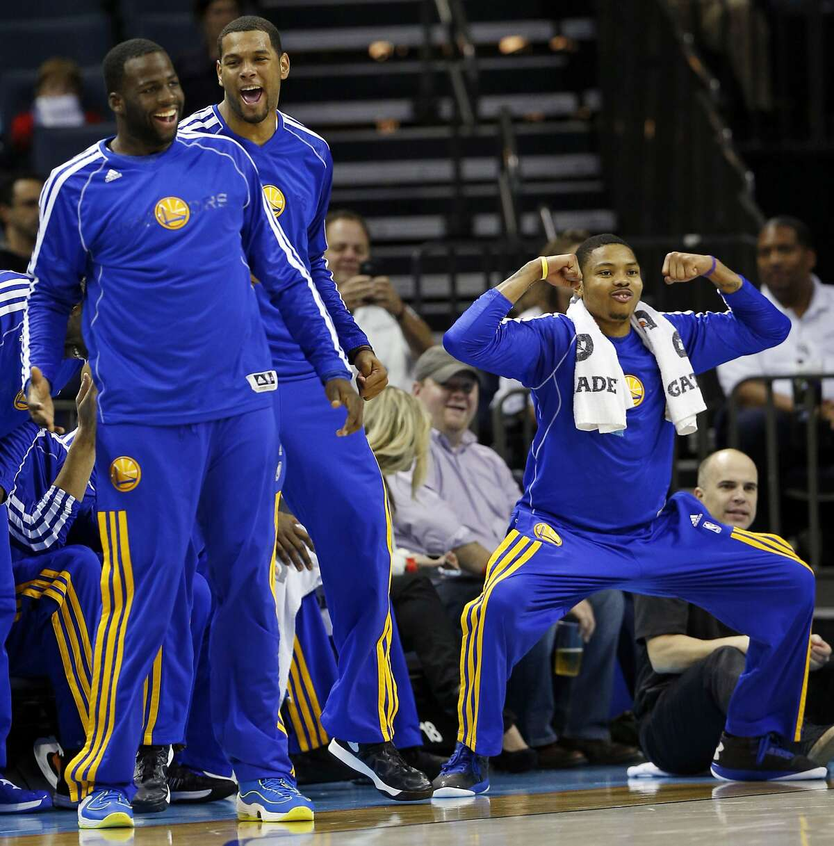 Golden State Warriors' Draymond Green, left, Jeremy Tyler, center, and Kent Bazemore react from the bench during the first half of an NBA basketball game against the Charlotte Bobcats in Charlotte, N.C., Monday, Dec. 10, 2012. (AP Photo/Chuck Burton)