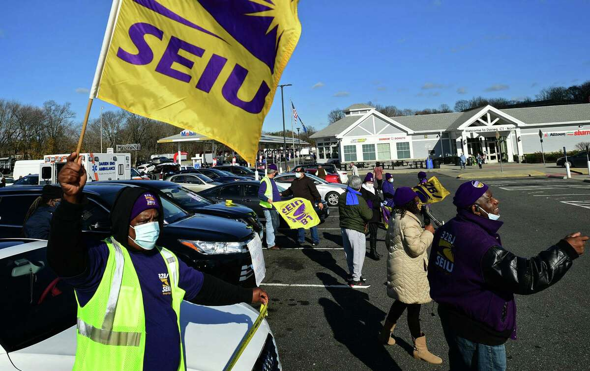 Members of SEIU local 32BJ join McDonald's franchise workers as they strike Tuesday at the I-95 northboard service plaza in Norwalk.
