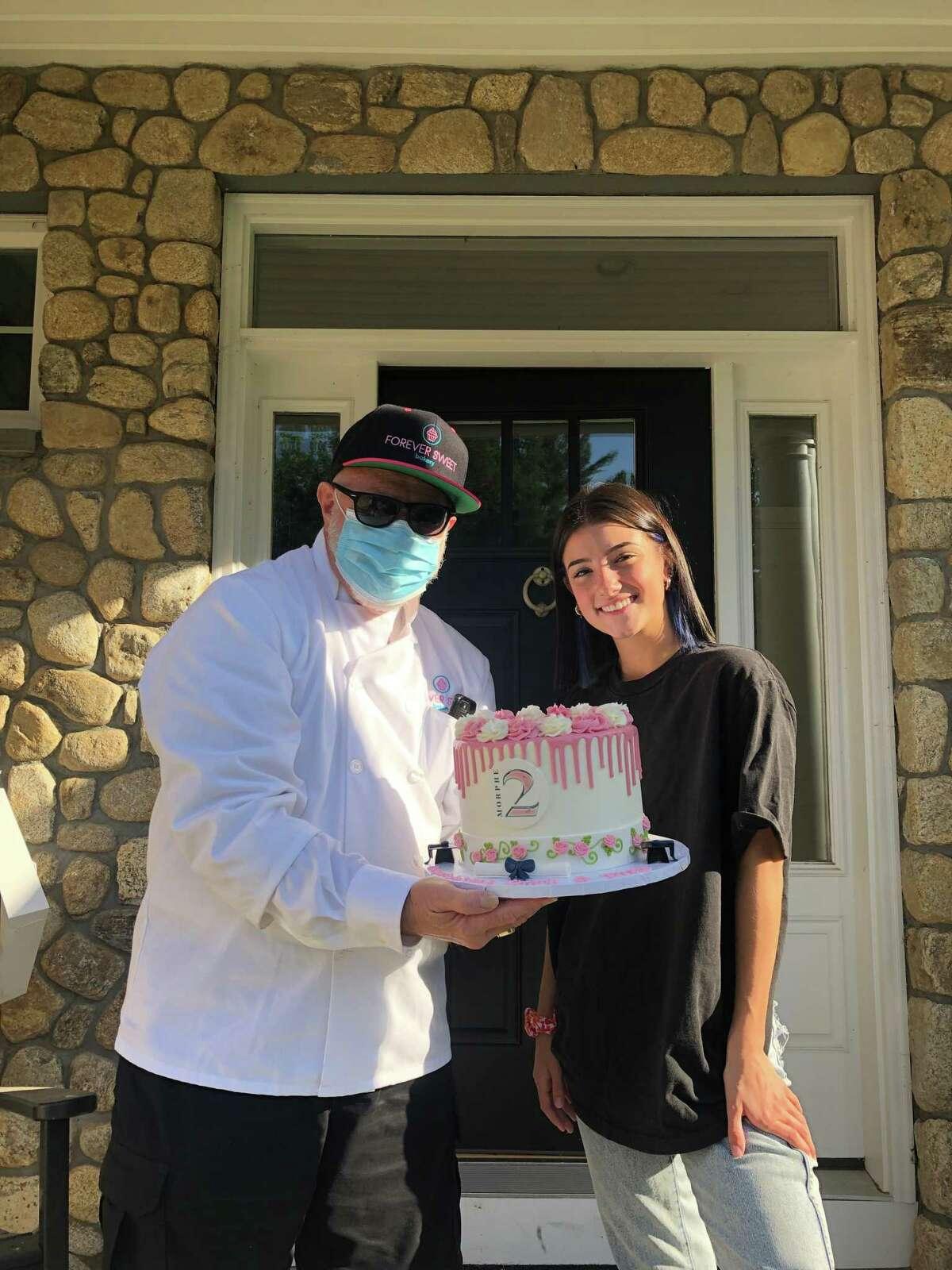 Social Media star Charli D'Amelio with SKY Mercede in front of Forever Sweet Bakery in Norwalk.