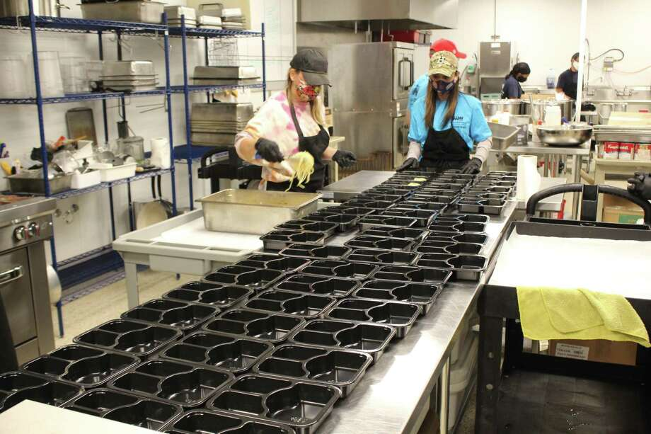 This year, Meals on Wheels Montgomery County will be delivering 692 meal bags to clients on Thanksgiving. Kitchen volunteers prepared hundreds of meals the morning of Nov 24, 2020 for clients across the county. Photo: Jamie Swinnerton