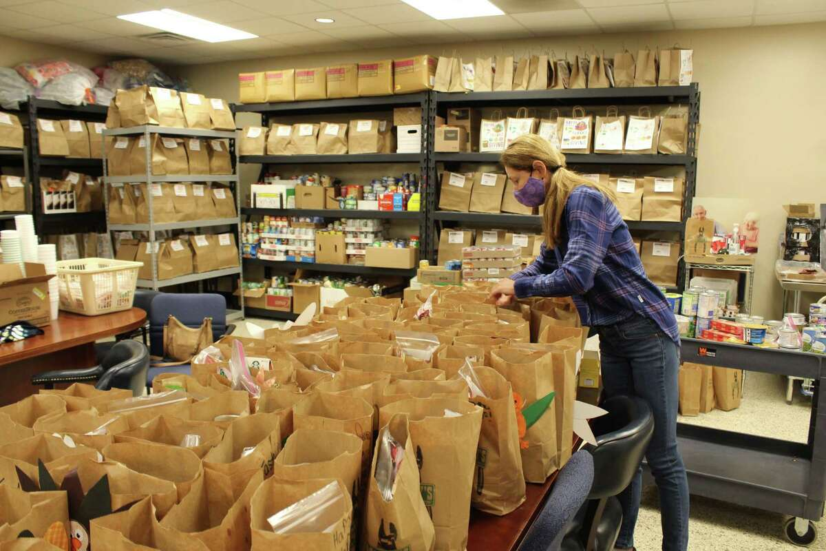 This year, Meals on Wheels Montgomery County will be delivering 692 meal bags to clients on Thanksgiving. Tania Shulkin, a regular volunteer at Meals on Wheels, fills the Thanksgiving bags with non-perishable items on Nov. 24, 2020.