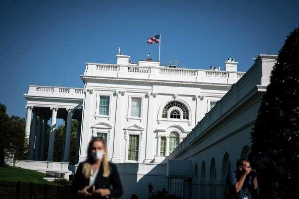 Reporters walk around outside the West Wing in October.