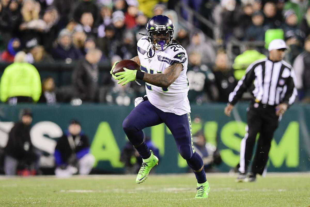 PHILADELPHIA, PENNSYLVANIA - JANUARY 05: Marshawn Lynch #24 of the Seattle Seahawks runs the ball against the Philadelphia Eagles in the NFC Wild Card Playoff game at Lincoln Financial Field on January 05, 2020 in Philadelphia, Pennsylvania. (Photo by Steven Ryan/Getty Images)