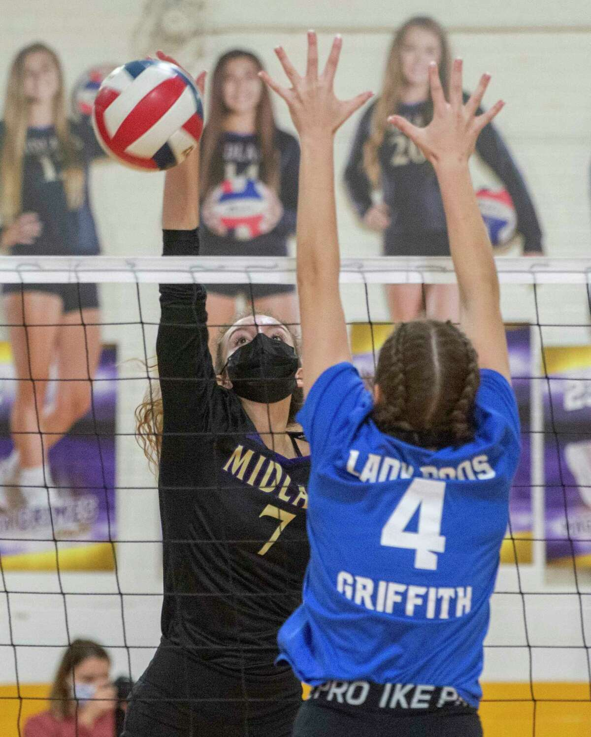 Midland High's Olivia Hale looks to hit past the reach of Westherford's Reiss Griffith 11/24/2020 at the Midland High gym.Tim Fischer/Reporter-Telegram.