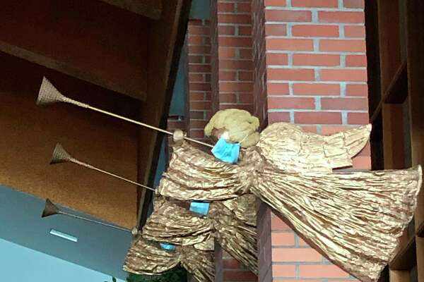 In a moment of jocularity, a custodian at Midland First United Methodist Church recently provided face masks for the Christmas angel figurines in the sanctuary. The church recently moved its worship services to a virtual format. (Photo provided/Facebook)