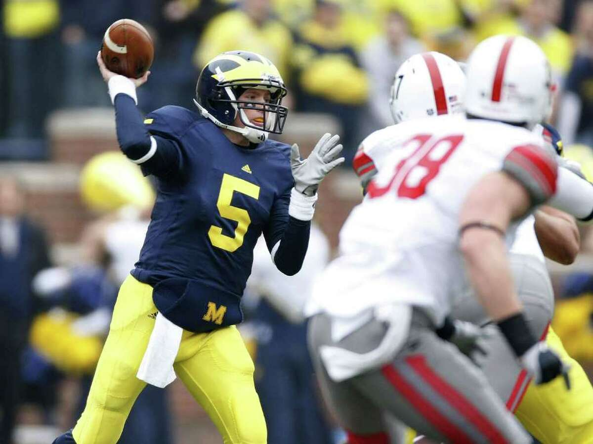 ANN ARBOR, MI - NOVEMBER 21: Tate Forcier #5 of the Michigan Wolverines throws a first quarter pass while playing the Ohio State Buckeyes on November 21, 2009 at Michigan Stadium in Ann Arbor, Michigan. (Photo by Gregory Shamus/Getty Images) *** Local Caption *** Tate Forcier