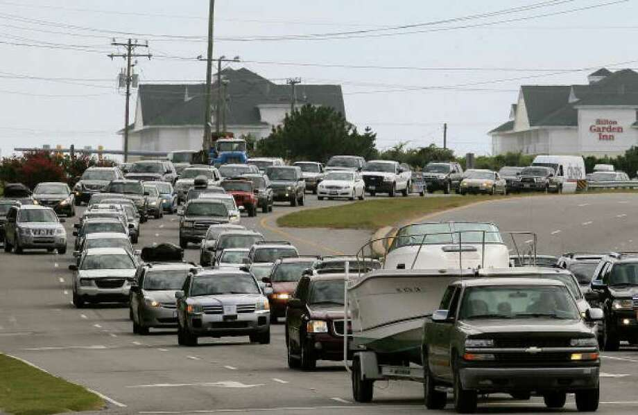 SOUTHERN SHORES, NC - SEPTEMBER 02:  Vehicles sit in traffic on the Croatan Highway as people evacuate the Outer Banks area September 2, 2010 in Southern Shores, North Carolina. A mandatory evacuation notice has been issued for Dare County as Hurricane Earl, which is expected to pass the outer banks of North Carolina late Thursday night into Friday morning, approaches.  (Photo by Mark Wilson/Getty Images) Photo: Mark Wilson, Getty Images / Getty Images
