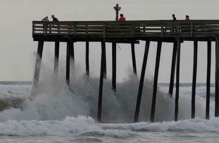 SOUTHERN SHORES, NC - SEPTEMBER 02: People stand on a pier as waves crash below them, on September 2, 2010 in Southern Shores, North Carolina. A hurricane warning has been issued for most of the North Carolina coastline due to the approaching category 4 hurricane Earl that is  expected to pass the outer banks of North Carolina late Thursday night into Friday morning.  (Photo by Mark Wilson/Getty Images) Photo: Mark Wilson, Getty Images / Getty Images