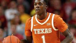 FILE - In this Feb. 15, 2020, file photo, Texas guard Andrew Jones drives upcourt during the second half of an NCAA college basketball game against Iowa State in Ames, Iowa. Jones is in his final season after his remarkable comeback from leukemia. (AP Photo/Charlie Neibergall, File)