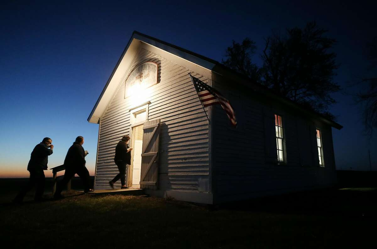 Voters enter a polling place at dusk to cast their ballots at Sherman Township Hall, a former one-room schoolhouse in Zearing, Iowa. The Iowa Poll, which proved accurate, showed the advantage of a state poll when the pollster knows voters' idiosyncrasies.