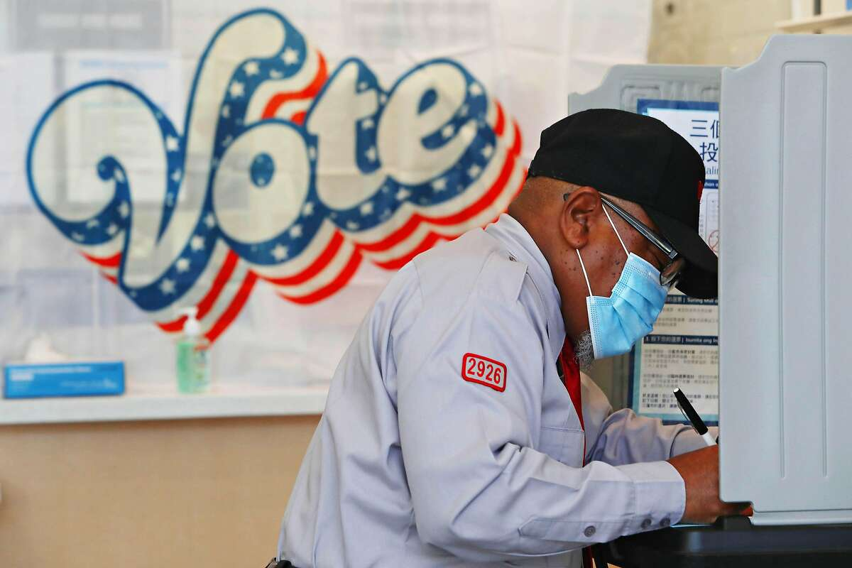 Larry McKinney completes his ballot at a polling place on Fillmore Street in S.F., but most Californians mailed their ballots.