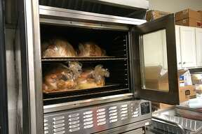 Volunteers cook the turkeys for the Bette J. Naffie Memorial Thanksgiving Dinner all day on the Tuesday before Thanksgiving.