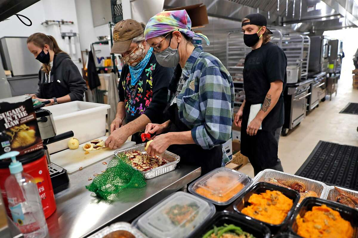 Chefs For the People workers prepare Thanksgiving meals for low-income families.