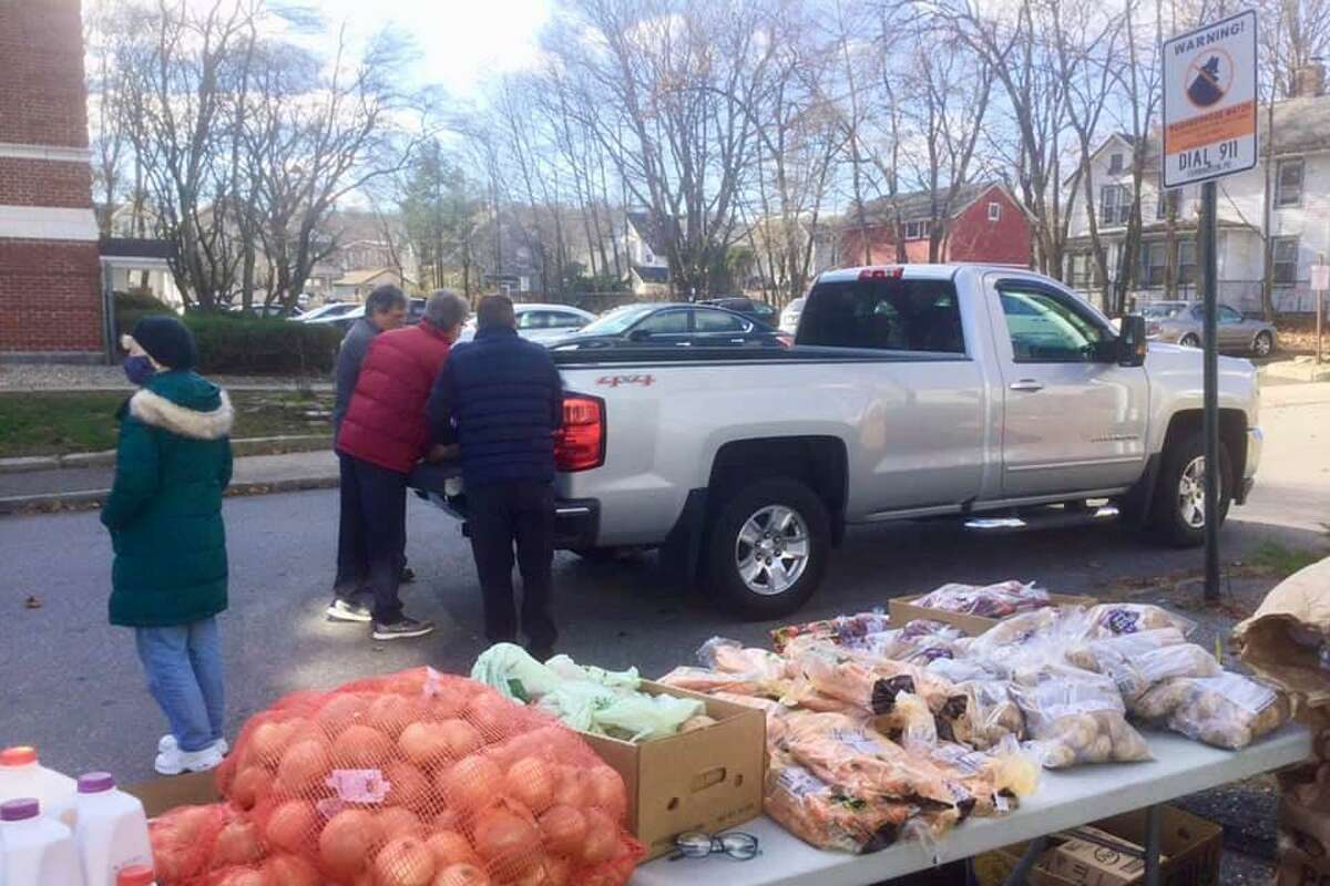 FISH of Torrington held its Thanksgiving food distribution event as a drive-up, pickup day Tuesday at the shelter on South Main Street.