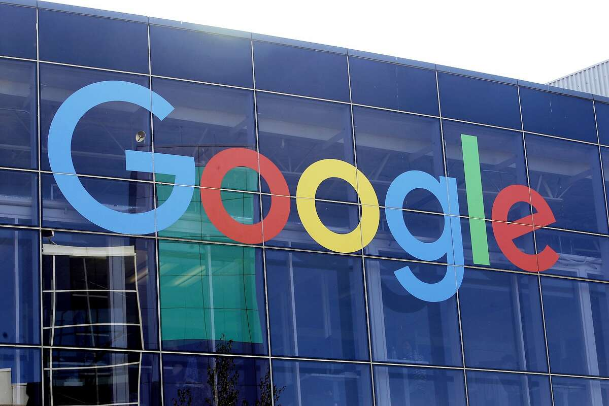 In this Sept. 24, 2019, file photo, a sign is shown on a Google building at their campus in Mountain View, Calif.