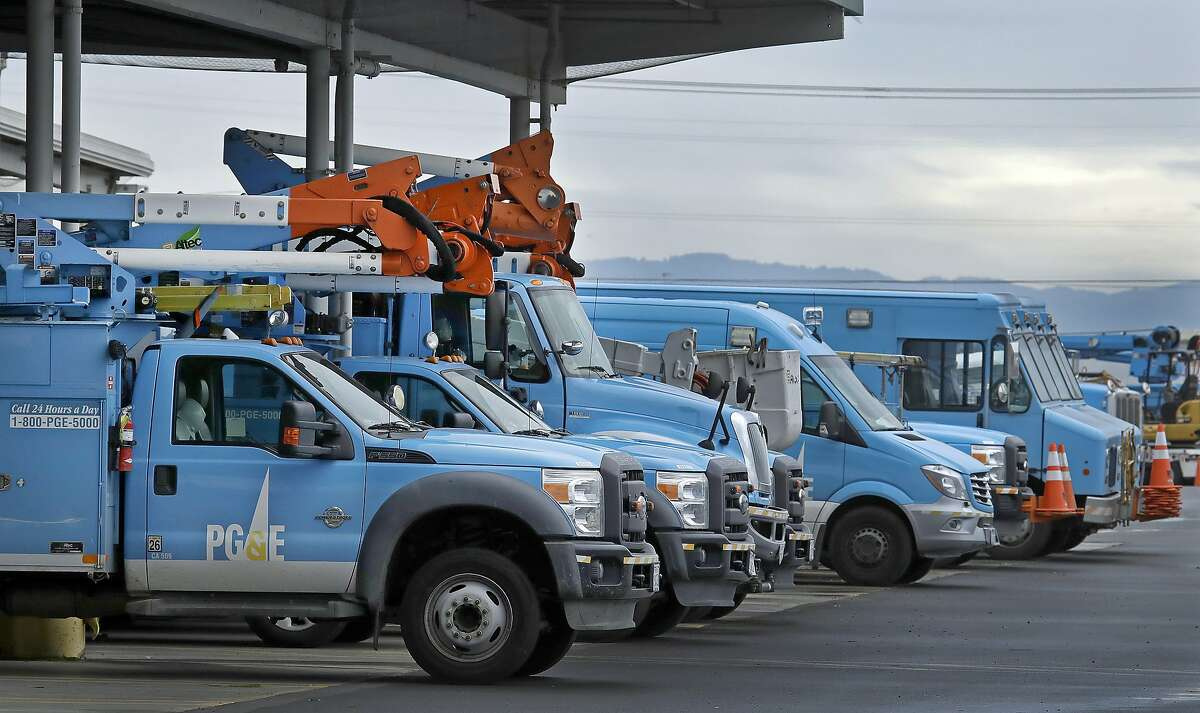 FILE - In this Jan. 14, 2019, file photo, Pacific Gas & Electric vehicles are parked at the PG&E Oakland Service Center in Oakland, Calif. (AP Photo/Ben Margot, File)