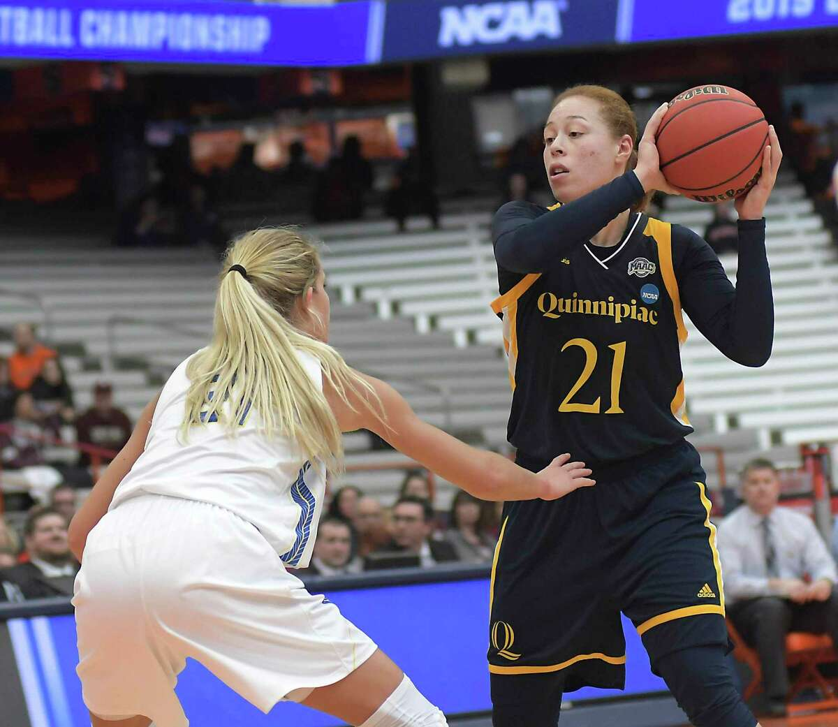 Quinnipiac's Jen Fay, right, looks to pass as South Dakota State's Tylee Irwin defends in an NCAA Tournament game in 2019. The Bobcats will host Providence on Wednesday at 1 p.m.
